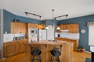 Photo 19: 57 Rocky Ridge Gardens NW in Calgary: Rocky Ridge Detached for sale : MLS®# A1098930