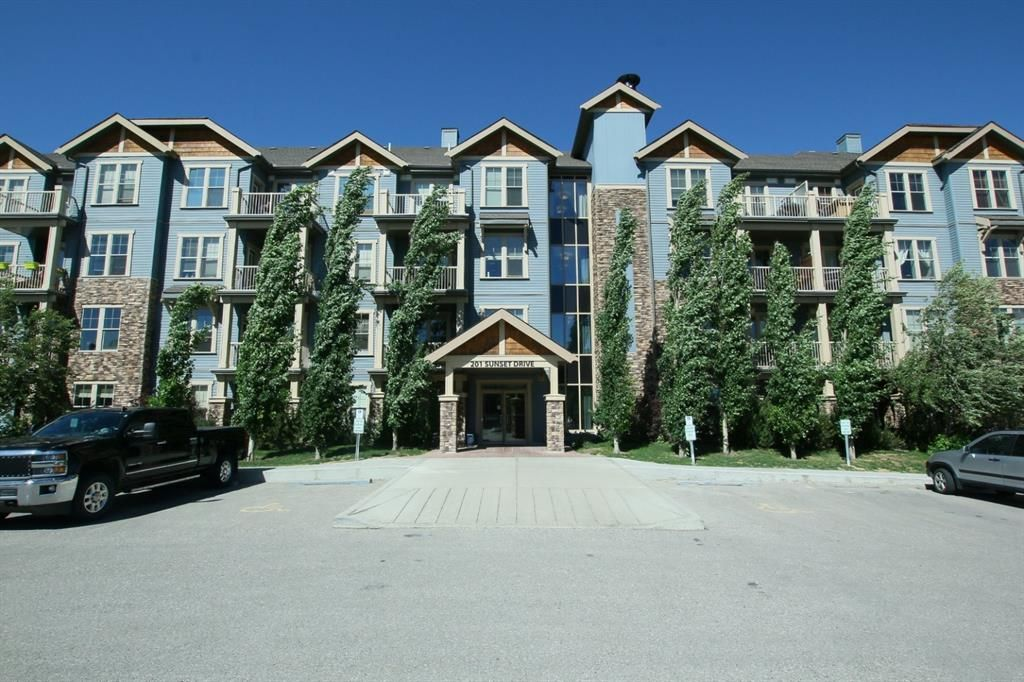 Main Photo: 120 201 SUNSET Drive: Cochrane Apartment for sale : MLS®# A1090461