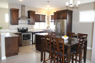 Photo 2: 69 Iron Wolf Boulevard: Lacombe Detached for sale : MLS®# A1099718