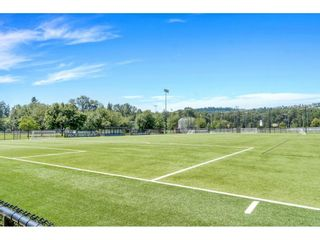 """Photo 33: 220 2110 ROWLAND Street in Port Coquitlam: Central Pt Coquitlam Townhouse for sale in """"AVIVA ON THE PARK"""" : MLS®# R2598714"""