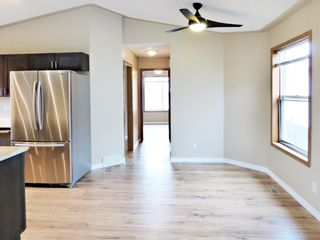 Photo 9: 107 Mt Allan Circle SE in Calgary: McKenzie Lake Detached for sale : MLS®# A1068557