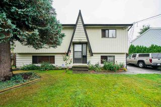 Photo 1: 10619 141 Street in Surrey: Whalley House for sale (North Surrey)  : MLS®# R2398756