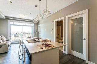 Photo 4: 311 100 Auburn Meadows Common SE in Calgary: Auburn Bay Apartment for sale : MLS®# A1093683