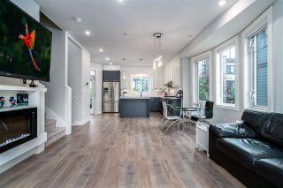 """Photo 1: 7 188 WOOD Street in New Westminster: Queensborough Townhouse for sale in """"River"""" : MLS®# R2585516"""