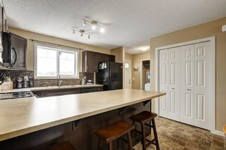 Photo 8: 94 SUNSET Road: Cochrane House for sale : MLS®# C4147363