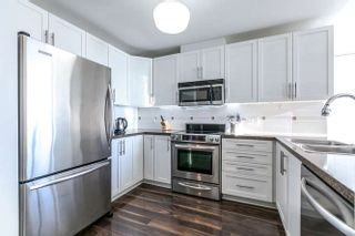 "Photo 1: 202 3880 CHATHAM Street in Richmond: Steveston Village Condo for sale in ""Chatham Place"" : MLS®# R2152334"