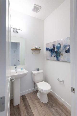 Photo 7: 25 Evanscrest Park NW in Calgary: Evanston Row/Townhouse for sale : MLS®# A1067562