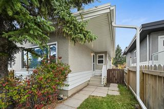 Main Photo: 2107 50 Avenue SW in Calgary: North Glenmore Park Semi Detached for sale : MLS®# A1151059