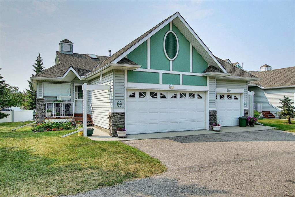Main Photo: 20 1008 Woodside Way NW: Airdrie Row/Townhouse for sale : MLS®# A1133633