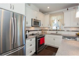 """Photo 12: 23 6929 142 Street in Surrey: East Newton Townhouse for sale in """"Redwood"""" : MLS®# R2110945"""
