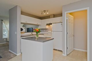 Photo 9: 163 Stonemere Place: Chestermere Row/Townhouse for sale : MLS®# A1040749