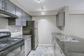 Photo 3: 106 5 Saddlestone Way NE in Calgary: Saddle Ridge Apartment for sale : MLS®# A1085165