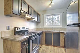 Photo 11: 161 7172 Coach Hill Road SW in Calgary: Coach Hill Row/Townhouse for sale : MLS®# A1101554