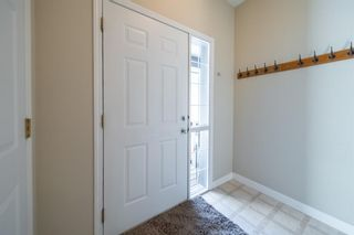 Photo 4: 404 720 Willowbrook Road NW: Airdrie Row/Townhouse for sale : MLS®# A1098346