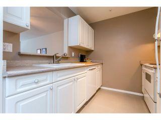 """Photo 6: 311 14885 100 Avenue in Surrey: Guildford Condo for sale in """"THE DORCHESTER"""" (North Surrey)  : MLS®# R2042537"""