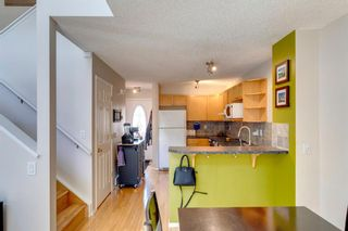 Photo 6: 418 Coral Cove NE in Calgary: Coral Springs Row/Townhouse for sale : MLS®# A1121739