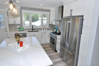 Photo 5: 235 99 Avenue SE in Calgary: Willow Park Residential for sale : MLS®# A1016375