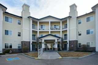 Photo 1: 101 72 Quigley Drive: Cochrane Apartment for sale : MLS®# A1091486