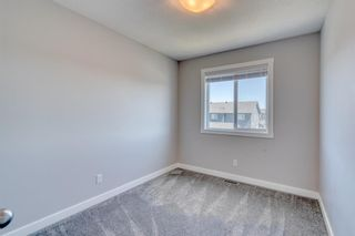 Photo 24: 70 Midtown Boulevard SW: Airdrie Row/Townhouse for sale : MLS®# A1126140