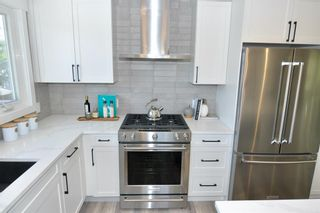 Photo 6: 235 99 Avenue SE in Calgary: Willow Park Residential for sale : MLS®# A1016375