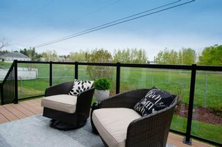 Photo 41: 32 Prominence Park SW in Calgary: Patterson Row/Townhouse for sale : MLS®# A1112438