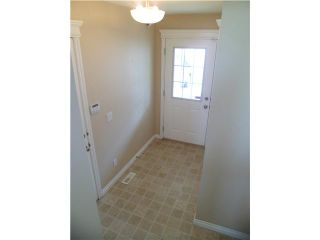 Photo 3: 86 CRYSTAL SHORES Cove: Okotoks Townhouse for sale : MLS®# C3535834