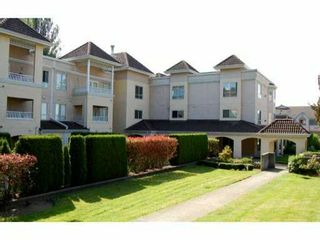 """Photo 1: 105 515 WHITING Way in Coquitlam: Coquitlam West Condo for sale in """"Brookside Manor"""" : MLS®# V903579"""