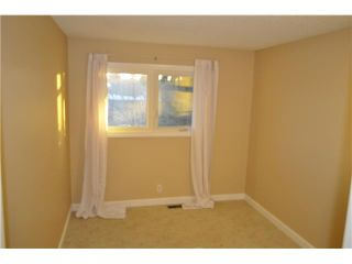 Photo 7: 557 SUMMERWOOD Place SE: Airdrie Residential Attached for sale : MLS®# C3592604