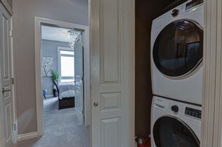 Photo 12: 7 124 Rockyledge View NW in Calgary: Rocky Ridge Row/Townhouse for sale : MLS®# A1111501
