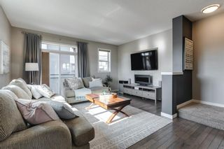 Photo 1: 604 Walden Circle SE in Calgary: Walden Row/Townhouse for sale : MLS®# A1083778