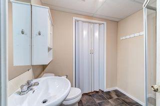 Photo 34: 32 800 Bowcroft Place: Cochrane Row/Townhouse for sale : MLS®# A1106385