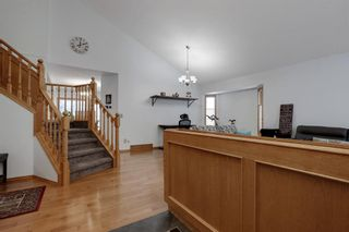 Photo 3: 210 Hawktree Bay NW in Calgary: Hawkwood Detached for sale : MLS®# A1062058