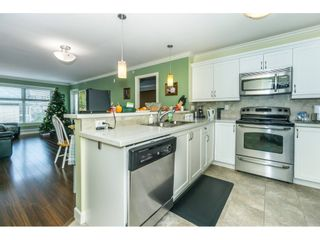 """Photo 7: 407 8084 120A Street in Langley: Queen Mary Park Surrey Condo for sale in """"Eclipse"""" (Surrey)  : MLS®# R2333868"""