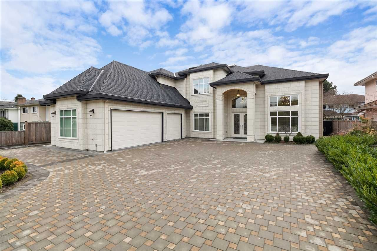 Stone Tile on the Full Front Exterior including the Garage.