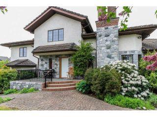 Photo 1: 8151 145B Street in Surrey: Bear Creek Green Timbers House for sale : MLS®# F1439980
