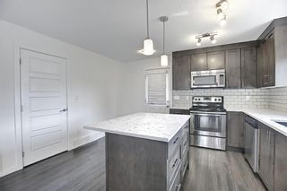Photo 9: 216 Cranford Mews SE in Calgary: Cranston Row/Townhouse for sale : MLS®# A1134650