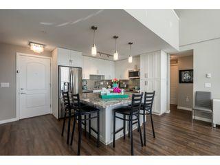 "Photo 3: 415 6490 194 Street in Surrey: Clayton Condo for sale in ""Waterstone"" (Cloverdale)  : MLS®# R2411705"