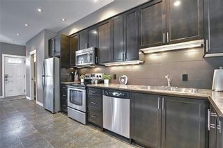 Photo 10: 4514 73 Street NW in Calgary: Bowness Row/Townhouse for sale : MLS®# A1081394