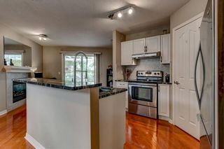 Photo 3: 8 2318 17 Street SE in Calgary: Inglewood Row/Townhouse for sale : MLS®# A1074008