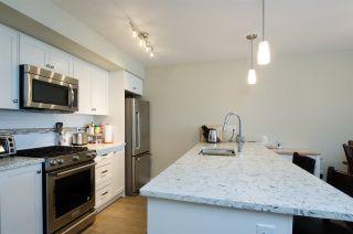 Main Photo: 302 4815 55B Street in Delta: Hawthorne Condo for sale (Ladner)  : MLS®# R2241679