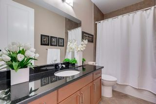 Photo 29: 34 Cougar Ridge Landing SW in Calgary: Cougar Ridge Row/Townhouse for sale : MLS®# A1075174