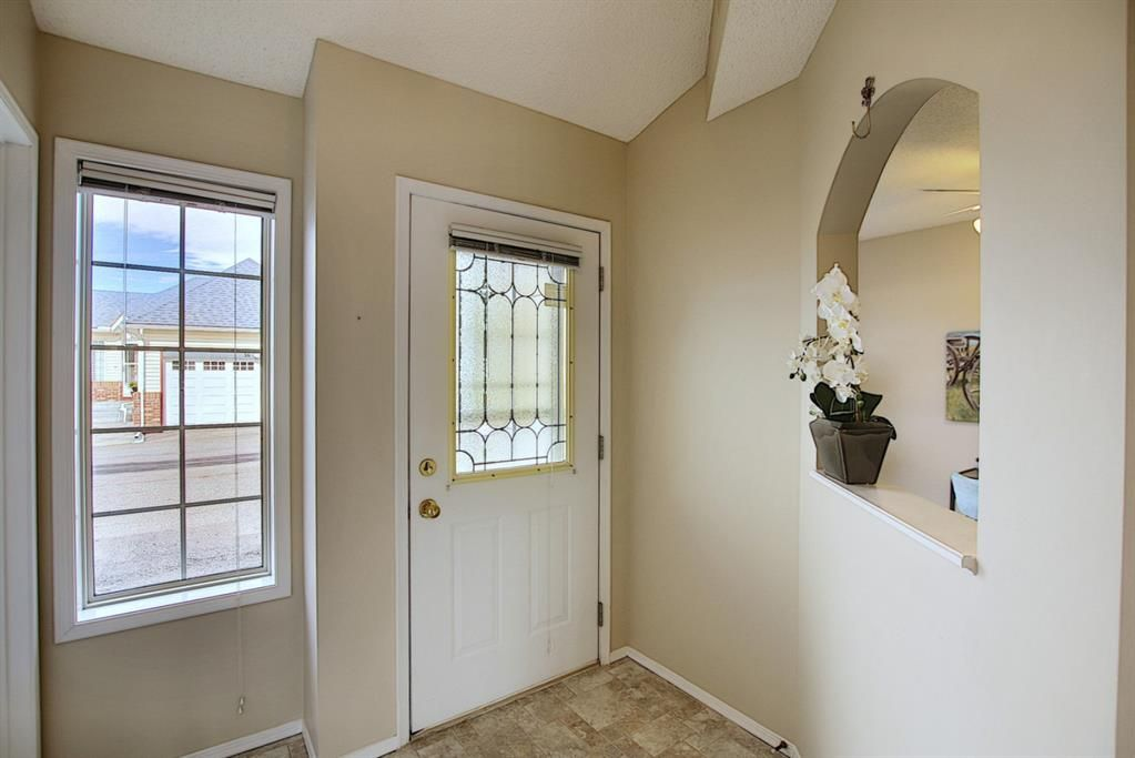 Main Photo: 8 12 Woodside Rise NW: Airdrie Row/Townhouse for sale : MLS®# A1108776