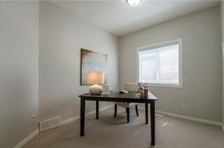 Photo 17: 26 STRATHLEA Crescent SW in Calgary: Strathcona Park House for sale : MLS®# C4139660