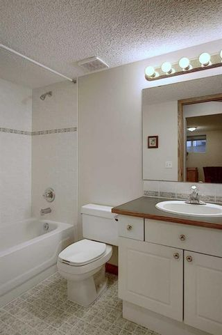 Photo 31: 13 Strathearn Gardens SW in Calgary: Strathcona Park Semi Detached for sale : MLS®# A1114770