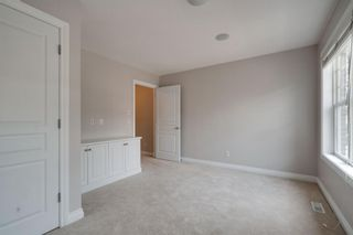 Photo 25: 2 10 St Julien Drive SW in Calgary: Garrison Woods Row/Townhouse for sale : MLS®# A1146015