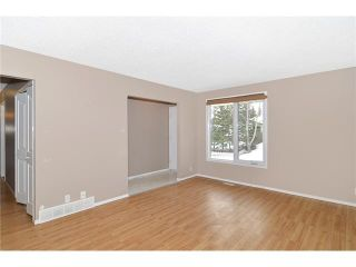 Photo 2: 409 RANCHVIEW Court NW in CALGARY: Ranchlands Residential Attached for sale (Calgary)  : MLS®# C3554095