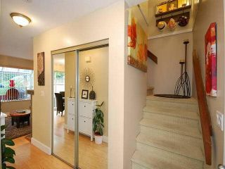 """Photo 2: 38 2736 ATLIN Place in Coquitlam: Coquitlam East Townhouse for sale in """"CEDAR GREEN ESTATES"""" : MLS®# V1137675"""
