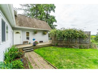 """Photo 3: 3003 208 Street in Langley: Brookswood Langley House for sale in """"Brookswood Fernridge"""" : MLS®# R2557917"""