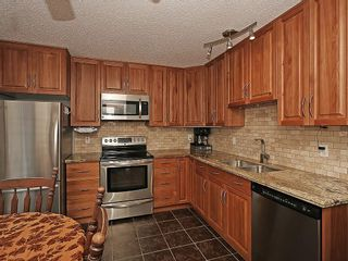 Photo 3: 121 999 CANYON MEADOWS Drive SW in Calgary: Canyon Meadows House for sale : MLS®# C4113761