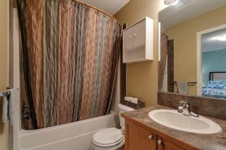 Photo 33: 704 Luxstone Square SW: Airdrie Detached for sale : MLS®# A1133096